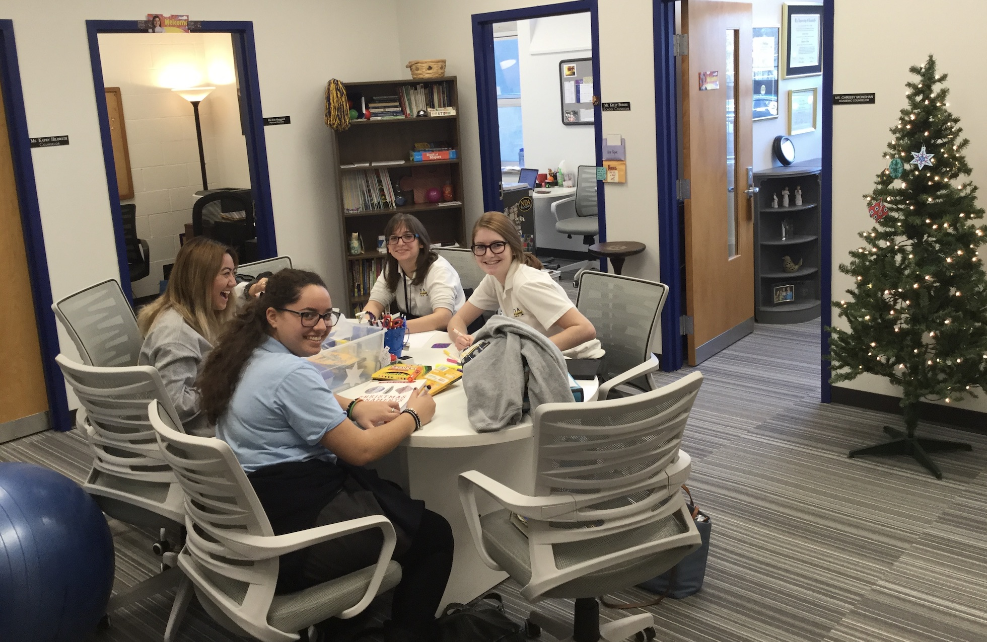 Students sitting at a table working together at Notre Dame Academy catholic all-girls school in Covington, Northern Kentucky.
