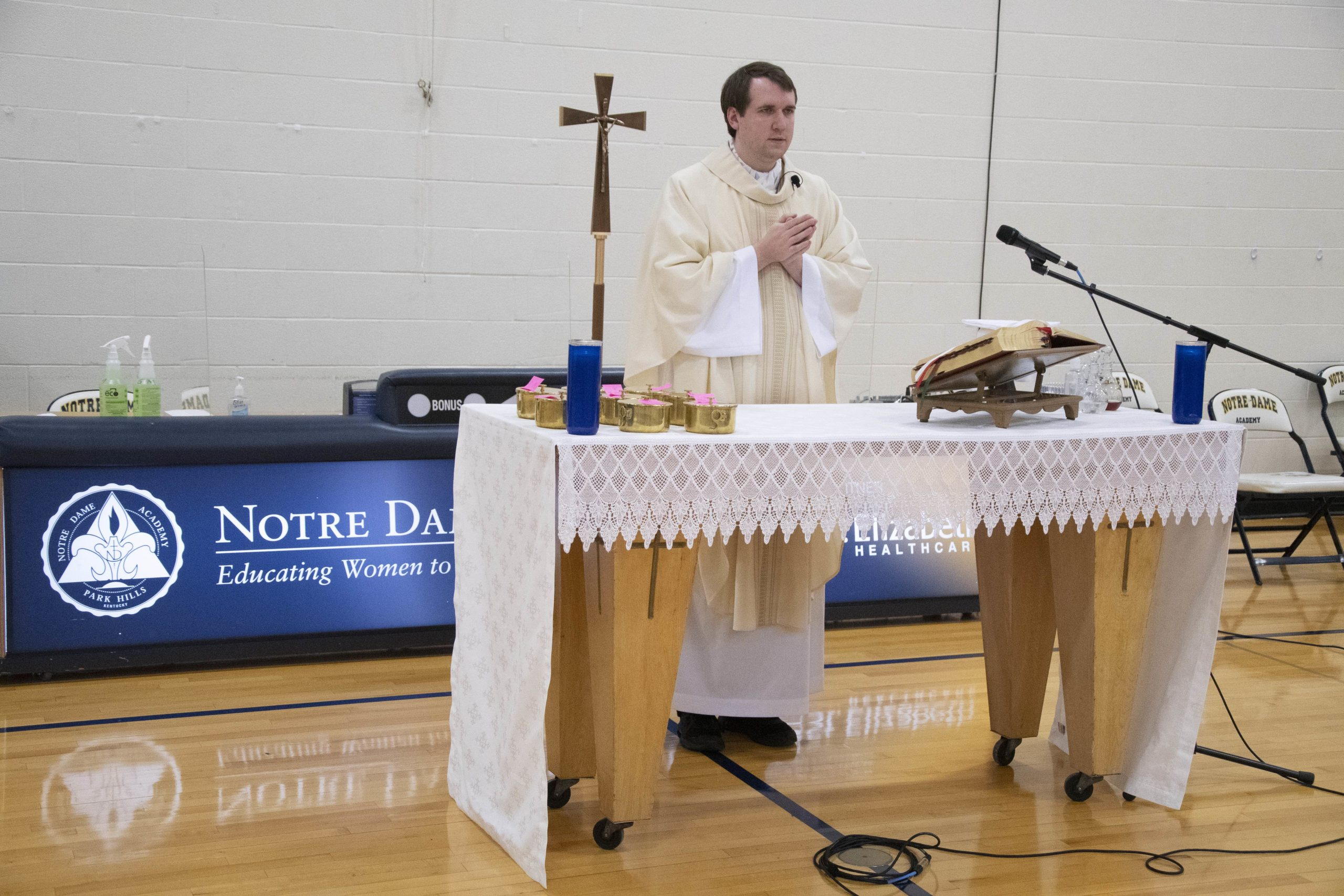 The chaplain saying Mass in the gym on 2021 at the Notre Dame Academy catholic all-girls school in Covington, Northern Kentucky.