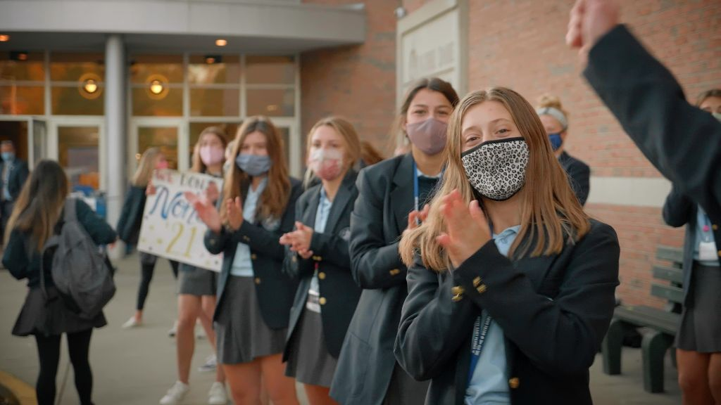 Students standing outside the main entrance welcoming other students at the Notre Dame Academy catholic all-girls school in Covington, Northern Kentucky.
