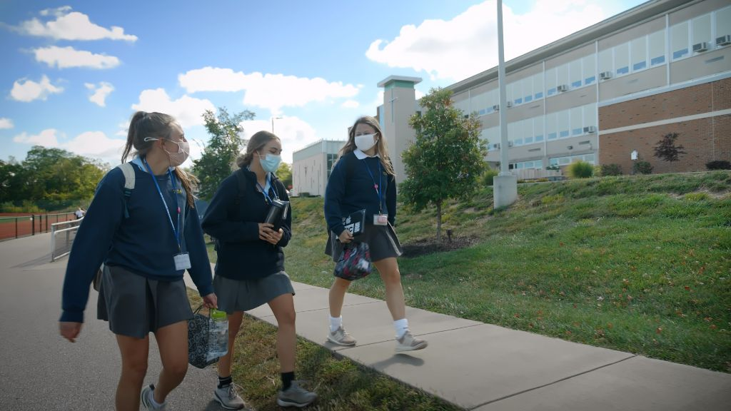 Students walking on a sidewalk outside the main building at the Notre Dame Academy catholic all-girls school in Covington, Northern Kentucky.