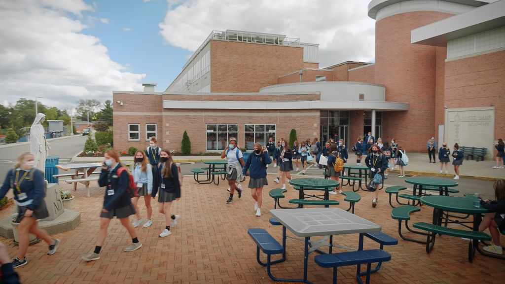 Students walking out of the main entrance after school at the Notre Dame Academy catholic all-girls school in Covington, Northern Kentucky.