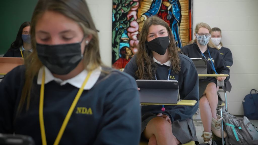 A view of a row of students sitting in a classroom at the Notre Dame Academy catholic all-girls school in Covington, Northern Kentucky.