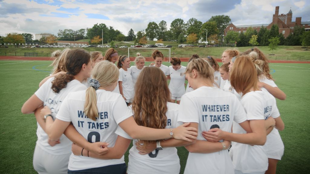 The soccer team huddled together during a timeout at a match at the Notre Dame Academy catholic all-girls school in Covington, Northern Kentucky.