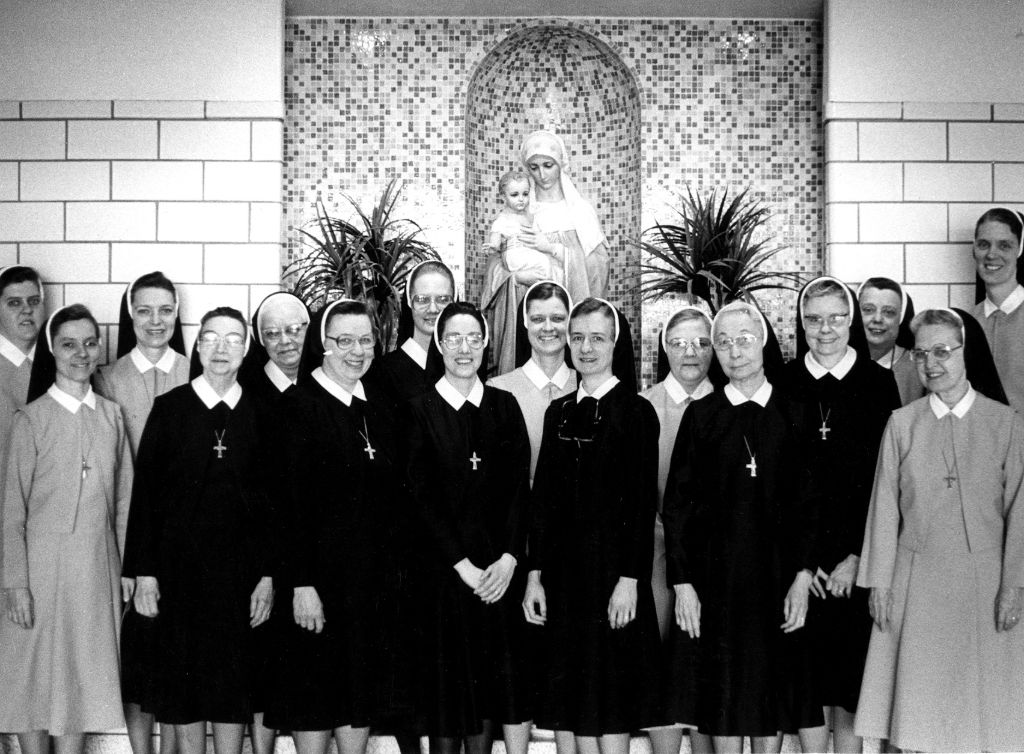 A vintage, black and white shot of the Sisters of Notre Dame at the Notre Dame Academy catholic all-girls school in Covington, Northern Kentucky.