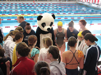 Notre Dame Academy catholic all-girls school swim team meeting for a team prayer before a competition.
