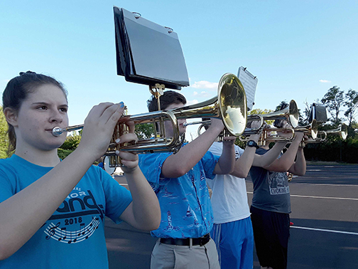 Students from Notre Dame Academy catholic all-girls school in Covington, Northern Kentucky practicing at a band rehearsal in the parking lot.